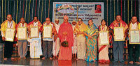 HONOUR:Gomateshwara Vidyapeeta awardees Padmaraja Dandavati, Dr T R Jodatti, H P Mohan Kumar, S V Jayasheelarao, Dr Preethi Shubhachandra, B P Nyamagowda and H C Hanumanthu are seen with Seer Charukeerthi Bhattaraka, Shambhukumar Kaslivala, Rajakumari Kaslivala, in Shravanabelagola on Sunday. DH PHOTO