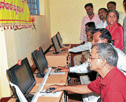 for a better future: Journalist Rajshekar Koti and MLC Sandesh Nagaraj inspect computers donated to Nazarbad Government High School by Mysore City Corporation , in Mysore on Tuesday. Former Deputy Mayor Sharadamma and others are also seen. DH photo