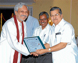 KPSC member Krishna Prasad receiving doctorate from Higher Education Minister and Pro Chancellor Dr V S Acharya at the second day of convocation in Mysore on Monday. Vice-Chancellor, University of Mysore, Prof V G Talwar is also seen.  dh photo