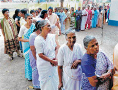 Women queue up to cast their votes during the Assembly elections in Kochi on Wednesday. PTI