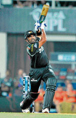 LOFTED SHOT Pune Warriors'Robin Uthappa hits a six during his knock of 31 against Kochi Tuskers on Wednesday. PTI