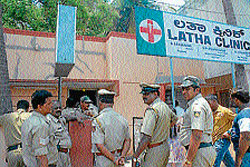 A police team on guard outside a nursing home, as doctors team inspects the facilities, in Mysore on Saturday. DH Photo