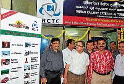 B B Verma, Divisional Railway Manager, South Western Railways at the inauguration of the IRCTC Tourism Facilitation Centre at the Railway station, in Mysore on Friday. (L-R) Senior Divisional Commercial Manager Dr Anup Dayanand Sadhu, ADRM, SWR, Mysore, R K Gupta, IRCTC Manager Rithesh and others are seen.  DH Photo