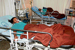 A man and his daughter who took ill after drinking tea mixed with a toxic substance lie in a hospital in Bijapur. dh photo