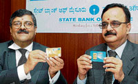 SBI Managing Director & Group Executive R Sridharan (right) with SBM Managing Director Dilip Mavinkurve launching the retail sale of gold coins, in Bangalore, on Monday. KPN