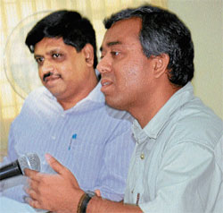 Deputy Commissioner Subodh Yadav (Right) speaking at a meeting.