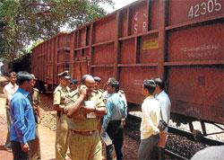Forest department seized iron ore being illegally transported in 57 bogies of a goods train at the Yeshwanthpur railway station, Sandur taluk, Bellary district on Wednesday. dh photo