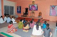 Mourning: Followers of Baba praying at the Sathya Sai Seva Kshetra at Chamarajapuram in Mysore on Sunday.  dh photo