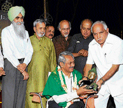 Honour: Chief Minister B S Yeddyurappa felicitates director Girish Kasaravalli on his 60th birthday in the City on Monday. Director of Department of Kannada and Culture Manu Baligar, former additional chief secretary Chiranjeevi Singh, writer U R Ananthamurthy, journalists T J S George and V N Subba Rao look on. DH Photo