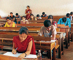 Students answering CET exam in one of the centres in Mangalore on Wednesday. DH photo