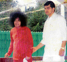 Confidant: Sathyajith with the Baba.