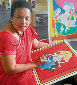 An artist giving final touch to one of the traditional paintings.DH photos/Hemanath Padubidri