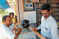 useful information The board looms in the background even as pharmacist Manjunath attends to customers, in Mysore.