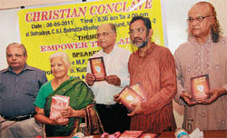 Justice M F Saldanha releasing the book 'Lost god and the church' at Christian Conclave in Mangalore on Sunday. dh photo