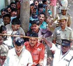 A file photo of cricket fans at the gates of Chinnaswamy Stadium in Bangalore.