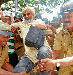 DEMONSTRATION: Police taking the CPM leader G N Nagaraj into their custody in Mysore, on Monday. DH Photo