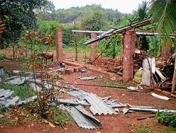 Heavy winds damaged and asbestos sheet of a shed at Narikombu village in Bantwal on Sunday. DH photo