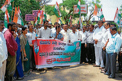 KPCC General Secretary M M Nanaiah, district Congress President B T Pradeep and others taking part in a protest against the State government in Madikeri on Tuesday.