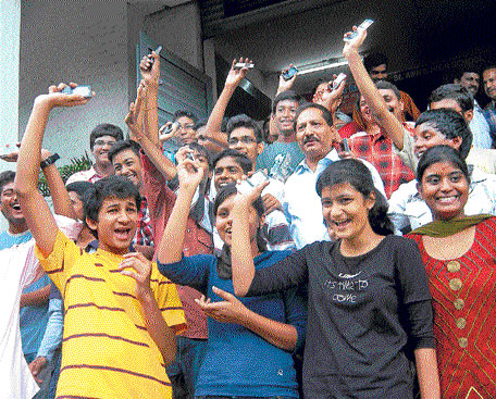 CELEBRATION TIME: Students who passed ICSE class X exams in a jubilant mood at a school  in Rajajinagar on Tuesday. KPN