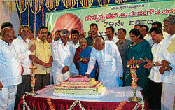 Former prime minister and MP H D Deve Gowda cutting a cake, on his 79th birthday in Mandya on Wednesday. Gowda's wife Channamma, MLAs C S Puttaraju, Kalpana Siddaraju,
