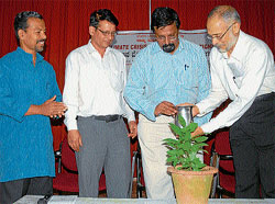 Awareness: Maj Gen (Retd) S G Vombatkere (extreme right) watering a sapling to inaugurate two-day workshop on 'Climatic Change - Solutions', organised at Dhvanyaloka, in Mysore on Wednesday. DH Photo