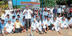 Congress leader G A Bhava speaking at the protest staged by Congress in front of DC's office in Mangalore on Thursday.
