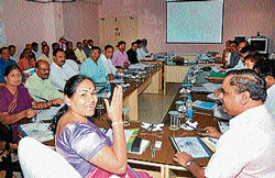 Energy Minister Shobha Karandlaje makes a point at a review meeting, at Cesc in Mysore on Saturday. Cesc MD Dr P Boregowda and others are seen. dh photo