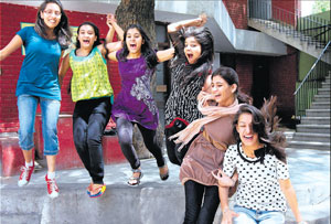 Students celebrate their success in the  CBSE class XII examinations, in a New Delhi school on Monday. PTI