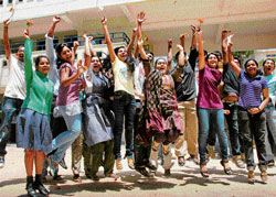 Jubilant: CBSE class XII students of Venkat International School in Bangalore on Monday rejoice after the announcement of results. DH PHOTO