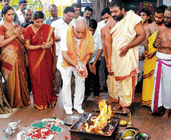 thanking the gods: Chief Minister B S Yeddyurappa performs a pooja with his family at Sanjayanagar Radhakrishna Temple in Bangalore on Tuesday. DH Photo