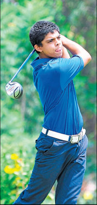 Syed Saqib Ahmed tees off in the  second round of Karnataka Junior golf meet on Wednesday. DH PHOTO
