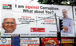 clarion call: A hoarding put up by members of India Against Corruption on Hosur Road. DH PHOTO