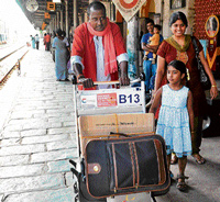 Easy on shoulders: Licensed porters carry luggage on a sleek trolley at the  Cantonment Railway station on Wednesday. DH PHOTO
