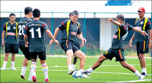 East Bengal coach Trevor Morgan (third from right) guides his players at a training session at the Bangalore Football Stadium on Friday. DH photo / B K Janardhan