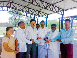 APMC committee members hand over the papers of the new shandy to Byrakuru Gram Panchayat members on Thursday. DH photo