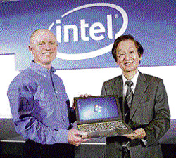 Intel Corporation Executive Vice President Sean Maloney (left) with AsusTek Computer Inc Chairman Jonney Shih hold an ASUS Ultrabook on the opening day of Computex computer expo, the world's second largest computer show, in Taipei, Taiwan, on Tuesday. AP
