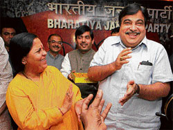 Back to square one: Uma Bharti shares a light moment with Bharatiya Janata Party president Nitin Gadkari in New Delhi on Tuesday. PTI