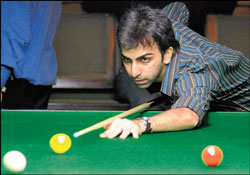 Pankaj Advani plays a shot during his facile quarterfinal win over Jasim Tawin. DH photo