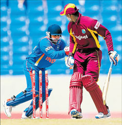 Parthiv Patel whips off the bails to leave Marlon Samuels stranded off the bowling of Amit Mishra in the third one-day international at the Sir Vivian Richards stadium in Antigua on Saturday. AFP