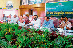 Zilla Panchayat President Ravi Kushalappa presiding over a meet held to discuss over the fertiliser supply issue, in Madikeri on Wednesday. DH Photo