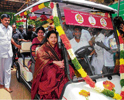 Tamil Nadu chief minister J Jayalalitha in the battery-driven car she donated to the ancient Sri Ranganathaswamy Temple in Srirangam near Tiruchirappalli on Sunday. DH photo