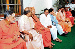 Karnataka Pradesh Congress Committee president G Parameshwara with the Lingayat mutt heads at his residence in Bangalore on Sunday. Former minister B K Chandrashekar is also seen. dh photo