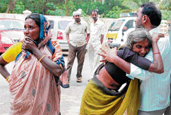 Relatives grieve the death of Sathyamma and her  children in Chitradurga on Thursday. DH Photo