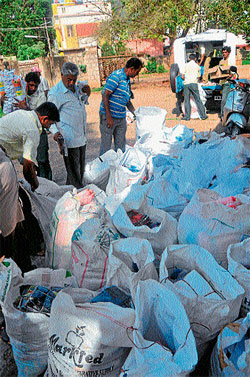 Mysore City Corporation officials seize banned plastic during a raid recently. DH PHOTO