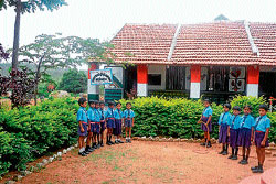 Students at the government school at Kajjikoppalu, Melukote hobli, Pandavapura taluk, Mandya district. DH Photo