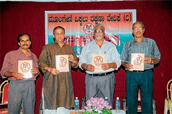 Legislative Council Member Captain Ganesh Karnik releasing an informative book on              Moolageni at a conference organised by Moolageni Okkalu Rakshana Vedike at Government Employees' Association Hall in Mangalore Sunday. DH Photo