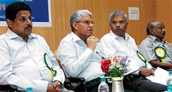 Met meet: Power Corporation of Karnataka Managing Director M Naveen Kumar, IMD Director General of Meteorology Ajit Tyagi, Principal Secretary of Tourism Department N C Muniyappa and Meteorological Centre Director R Asokan at a meet on weather services, in Bangalore on Monday.  DH photo