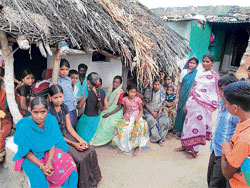 women power: Dalit women at the Harijankeri of Mevundi in Gadag district are set against the plans of their men to sell the lands.  dh photo