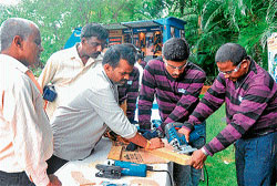Bosch staff demonstrate the use of power tools to the artisans at a training programme in Mysore on Thursday. DH Photo