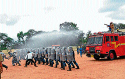 Rapid Action Force personnel display their skills at the district police parade grounds in Chamarajanagar on Sunday. DH photo